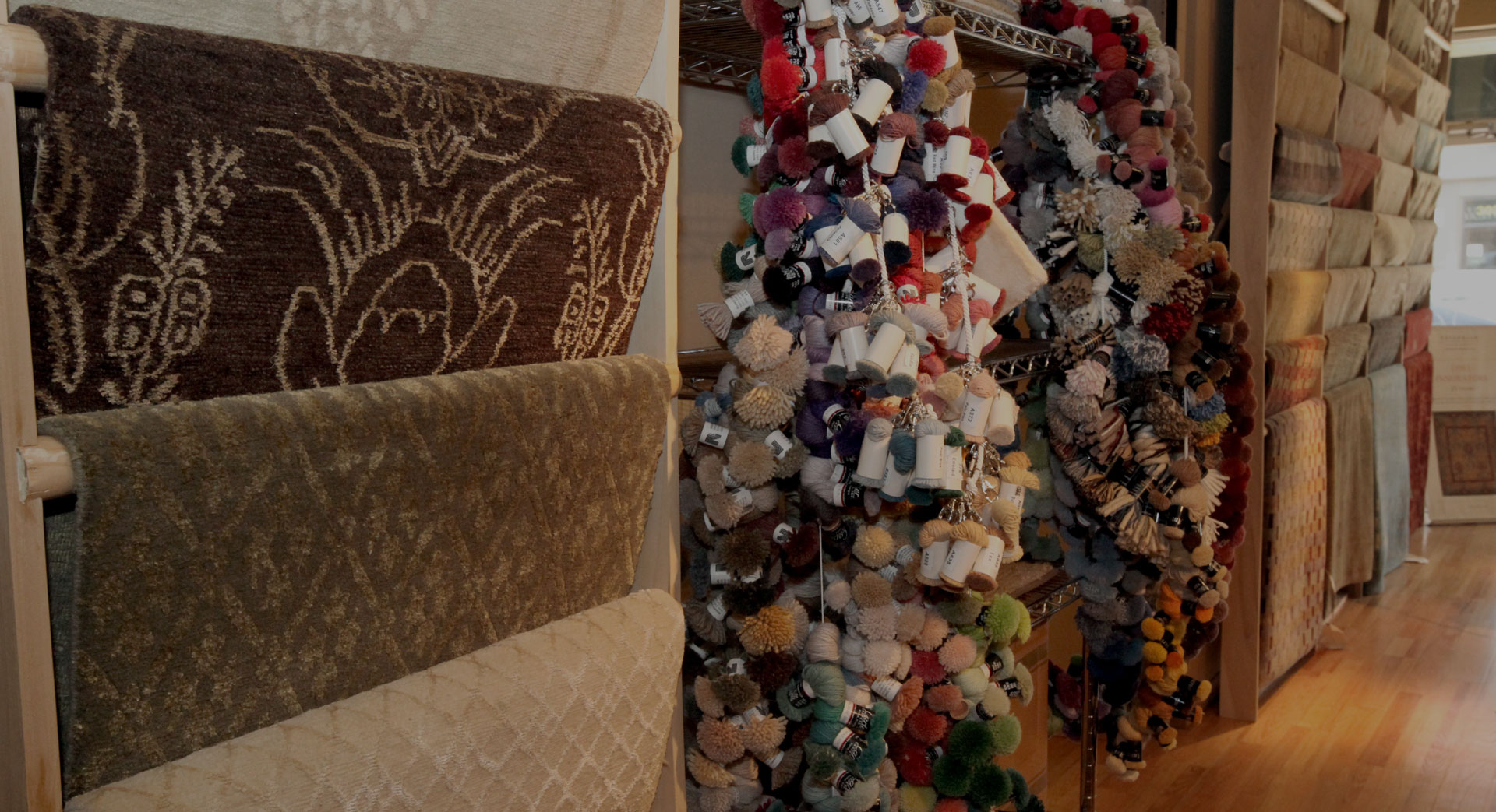 Vertical pole of hundreds of rolls of yarn for custom purposes