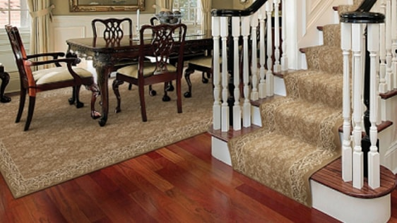 wooden stairs with a brown patterned stair runner
