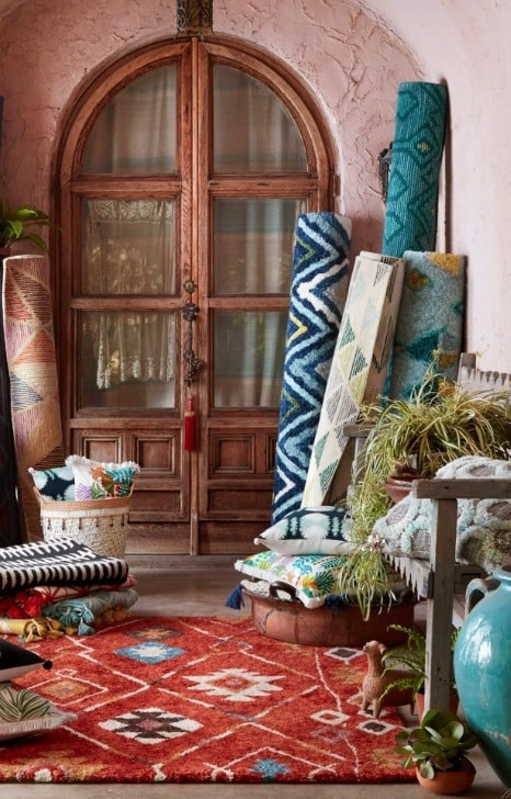 Rugs stacked in corner
