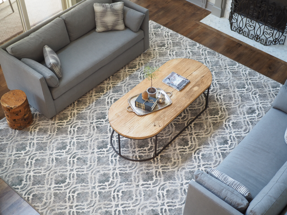 Grey with white waves rug in living room