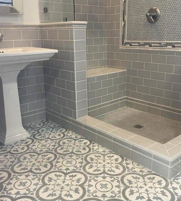 Grey rectangular tile in shower